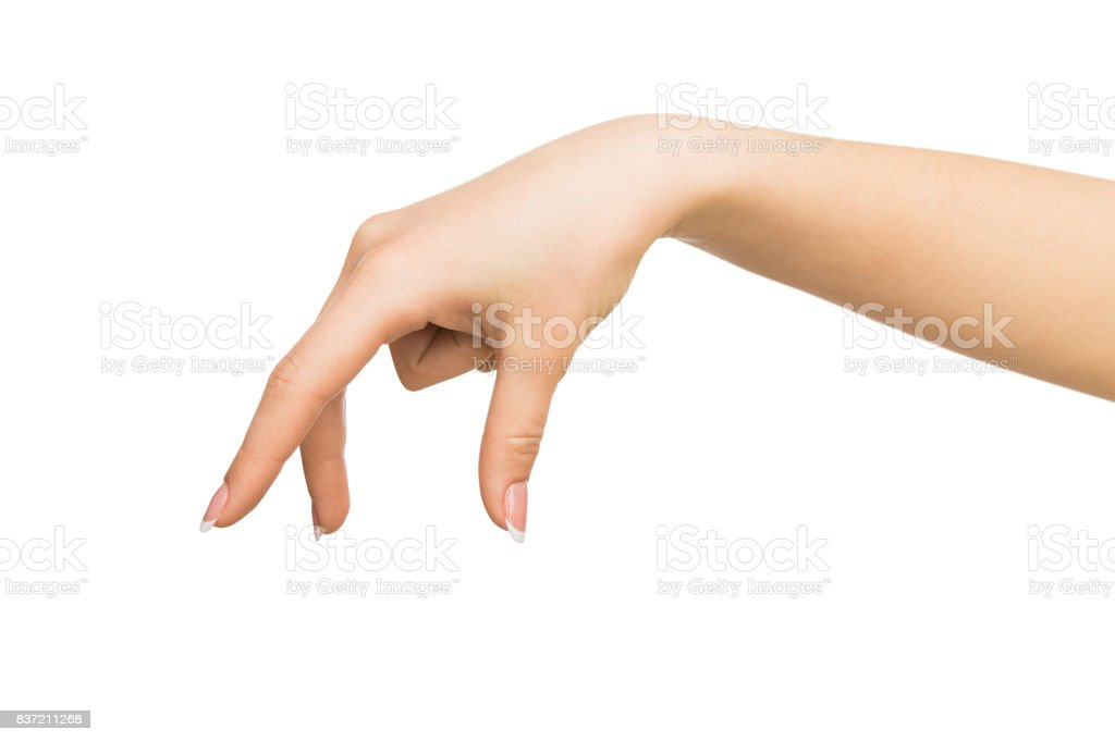 Female hand picking up something, cutout stock photo