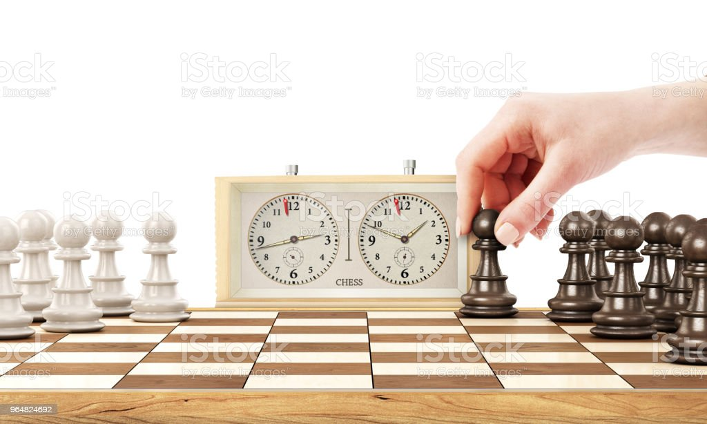 Female hand playing chess on a white background royalty-free stock photo