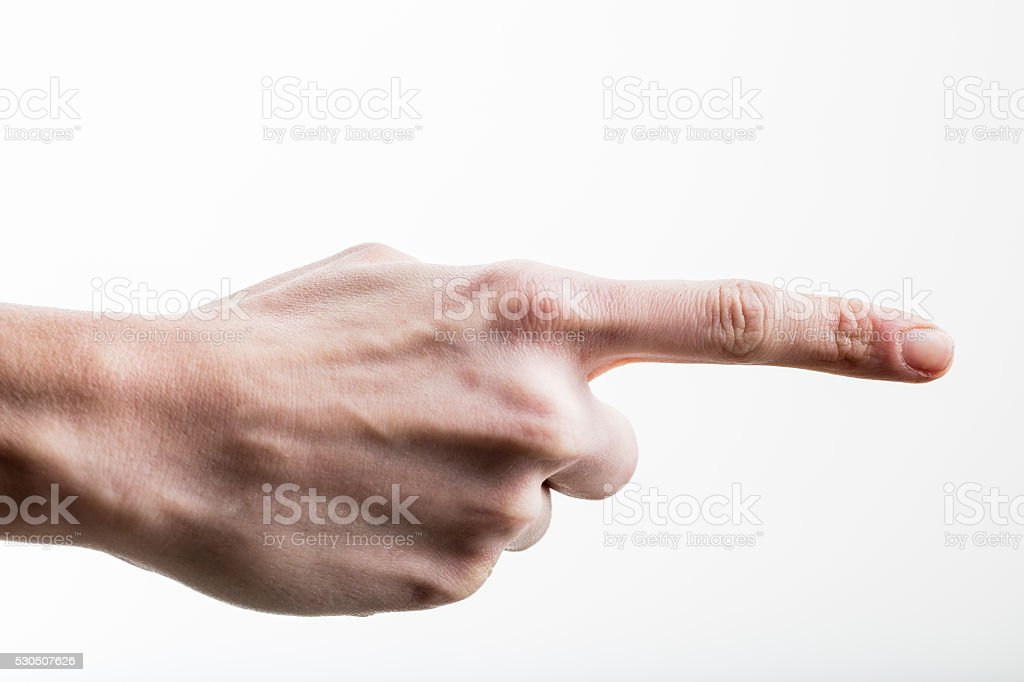 female hand pointing her index finger out stock photo