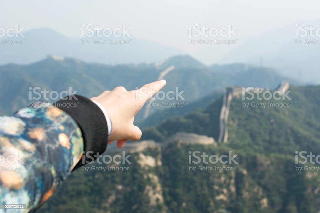 Female hand pointing the Great Wall of China royalty-free stock photo