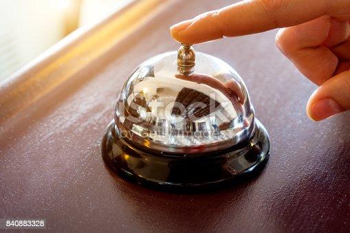 istock female hand presses the button 840883328