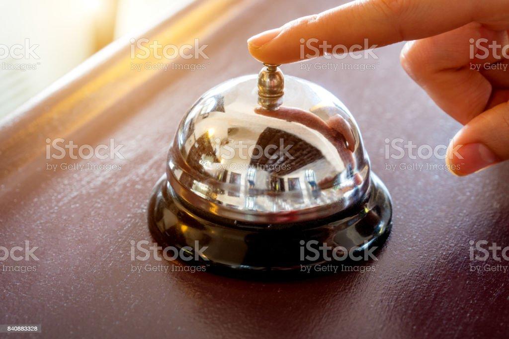female hand presses the button stock photo