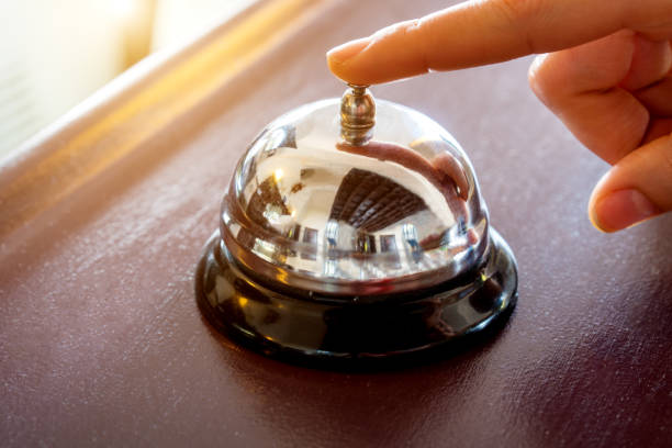 female hand presses the button - bell stock pictures, royalty-free photos & images