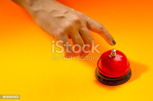 istock Female Hand ringing in red service bell 858985602