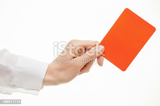 istock Female hand showing a red card 496511114
