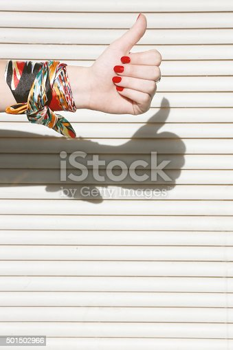 istock Female hand showing like sign with thumb up 501502966