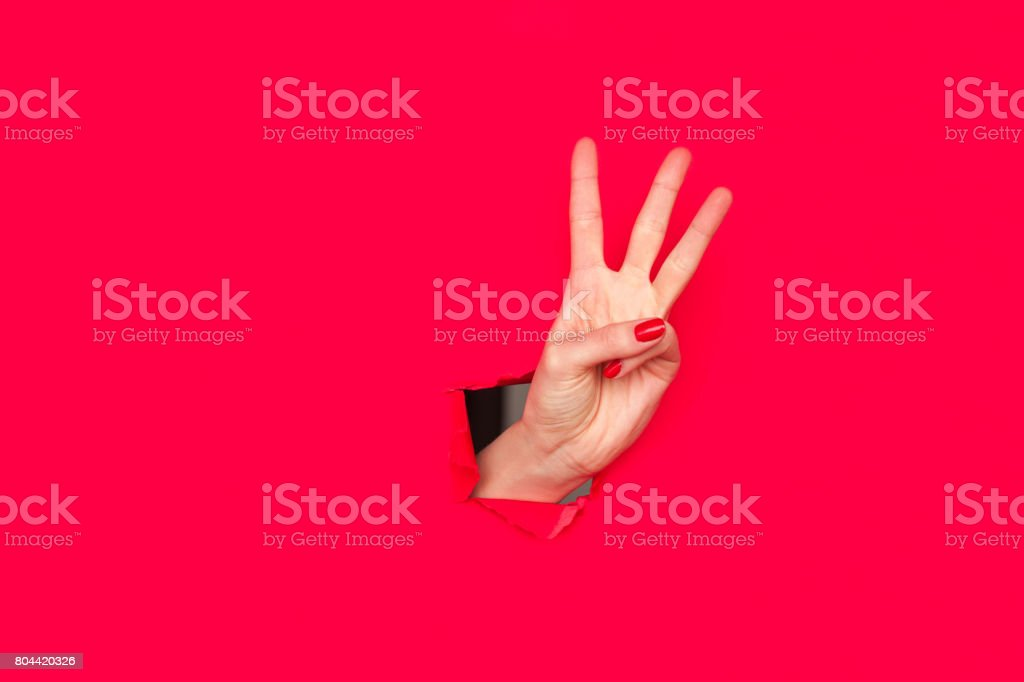 Female hand showing three fingers stock photo