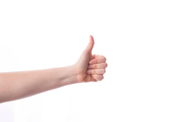 weibliche hand mit daumen nach oben, isoliert auf weiss - bester nagellack stock-fotos und bilder