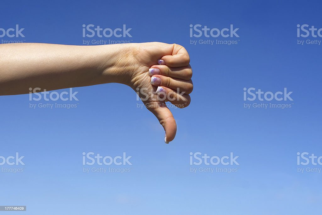 Female hand showing thumbs down royalty-free stock photo