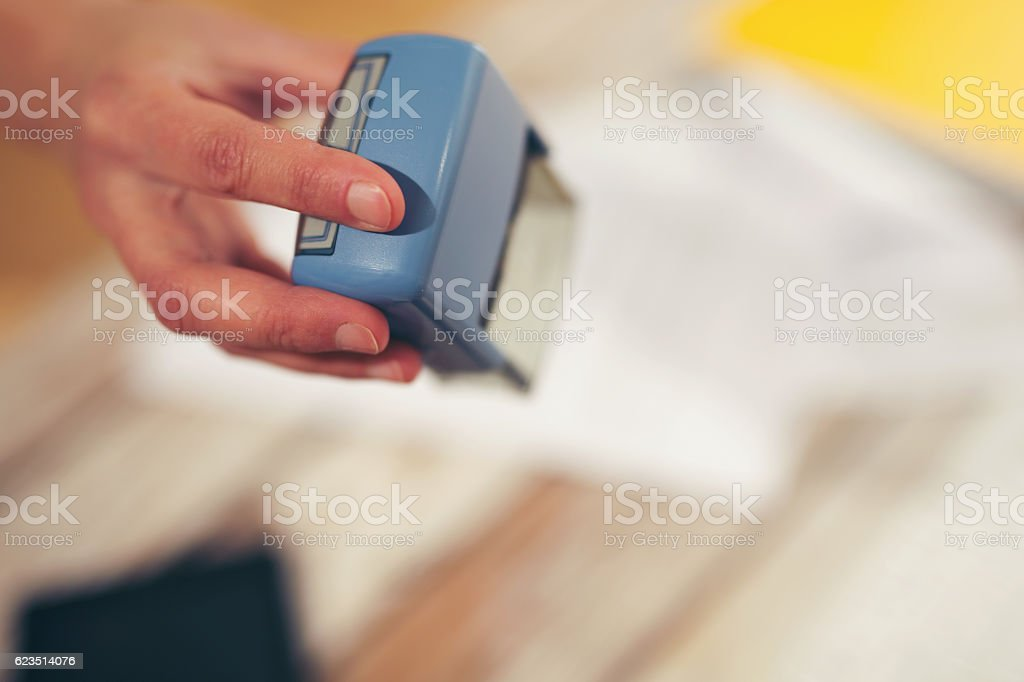 Female hand stamping document, working at office stock photo
