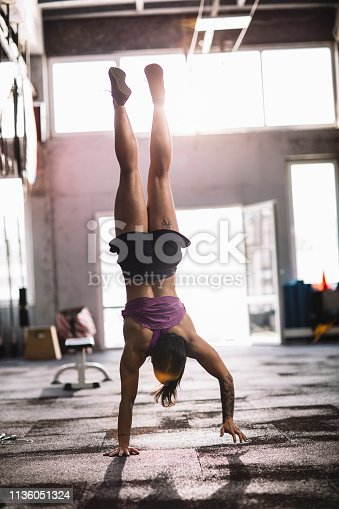 Young athletic women hand standing on her training in the gym