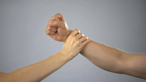 Female hand stopping male arm before attack, stop assault in family, violence Female hand stopping male arm before attack, stop assault in family, violence self defense stock pictures, royalty-free photos & images