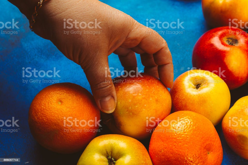 Female hand takes an apple stock photo
