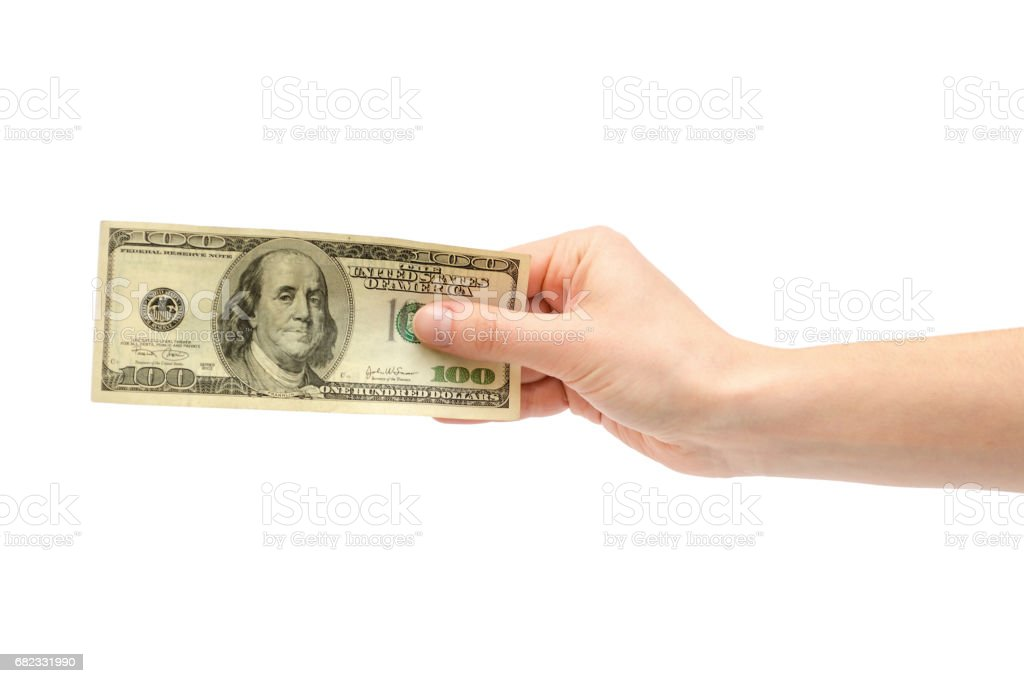 female hand takes or gives one hundred US dollars. stock photo