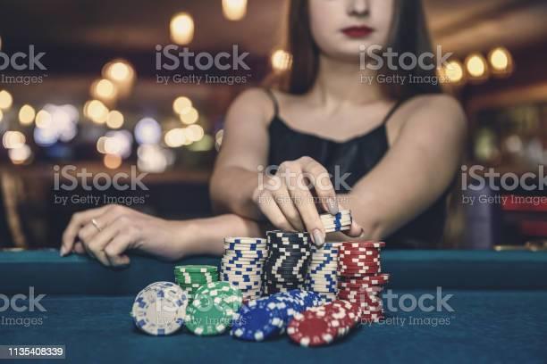 Female hand taking poker chips from pile picture id1135408339?b=1&k=6&m=1135408339&s=612x612&h=n3pynqkina3kweb y7diu wpmvcaitrrc3djbvunxbq=