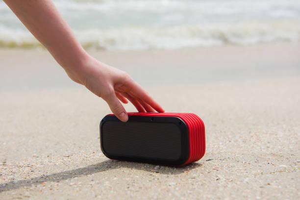 female hand touch portable speaker - bluetooth foto e immagini stock