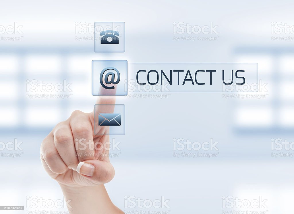 Female hand touching contact us button stock photo