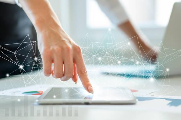 Female hand touching technologies stock photo