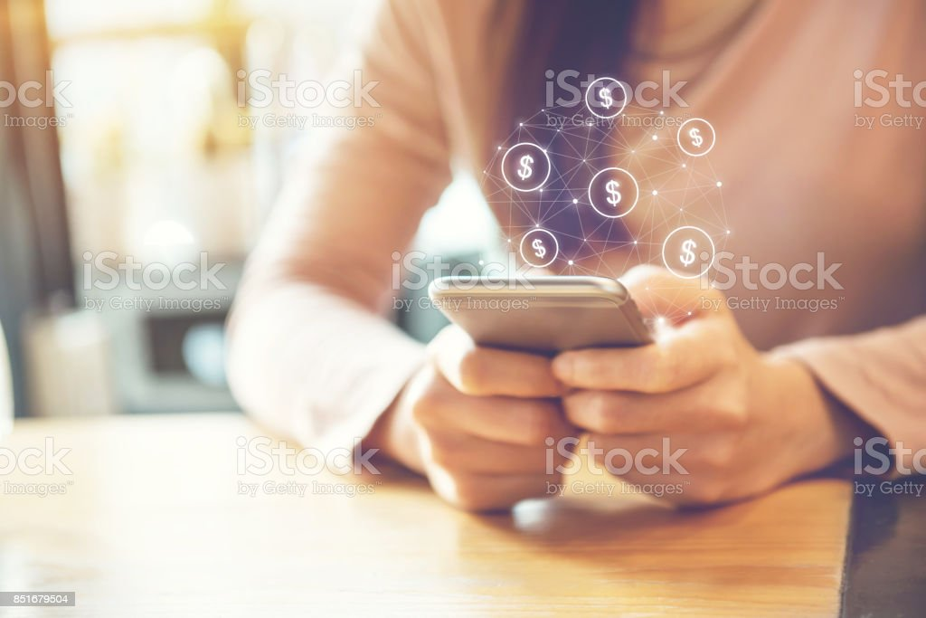 Female Hand using mobile smartphone with dollar icon stock photo