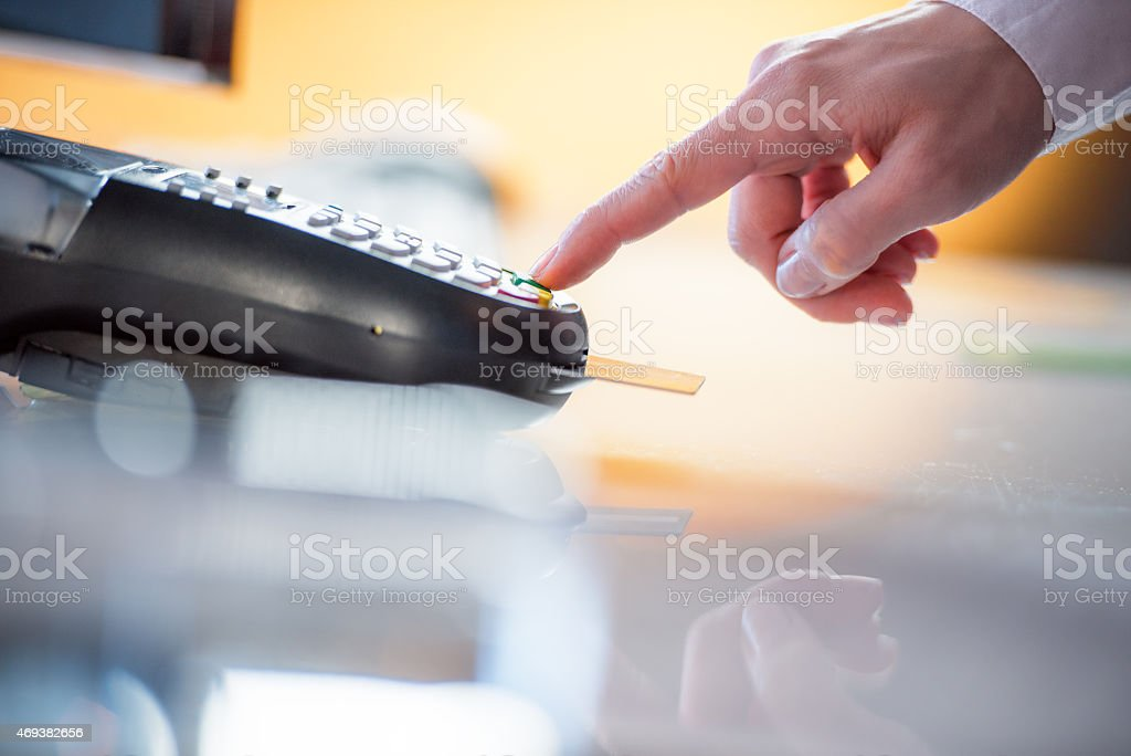 Female hand using smart card reader stock photo