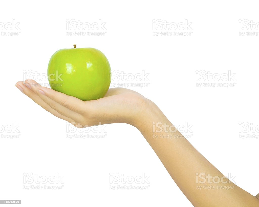 Female hand with a green apple on white royalty-free stock photo