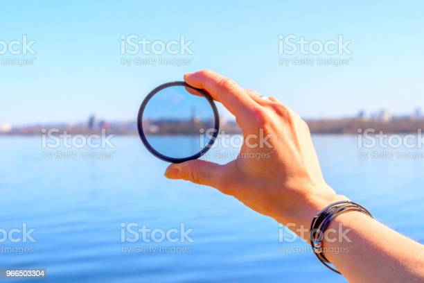 Female hand with a photo filter on the background of the lake and the picture id966503304?b=1&k=6&m=966503304&s=612x612&h=8okers8woqxasp 8dqv8isrcznrv7o0yeqwtl jaqac=