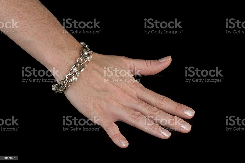 Female Hand with Bracelet (Isolated) royalty-free stock photo