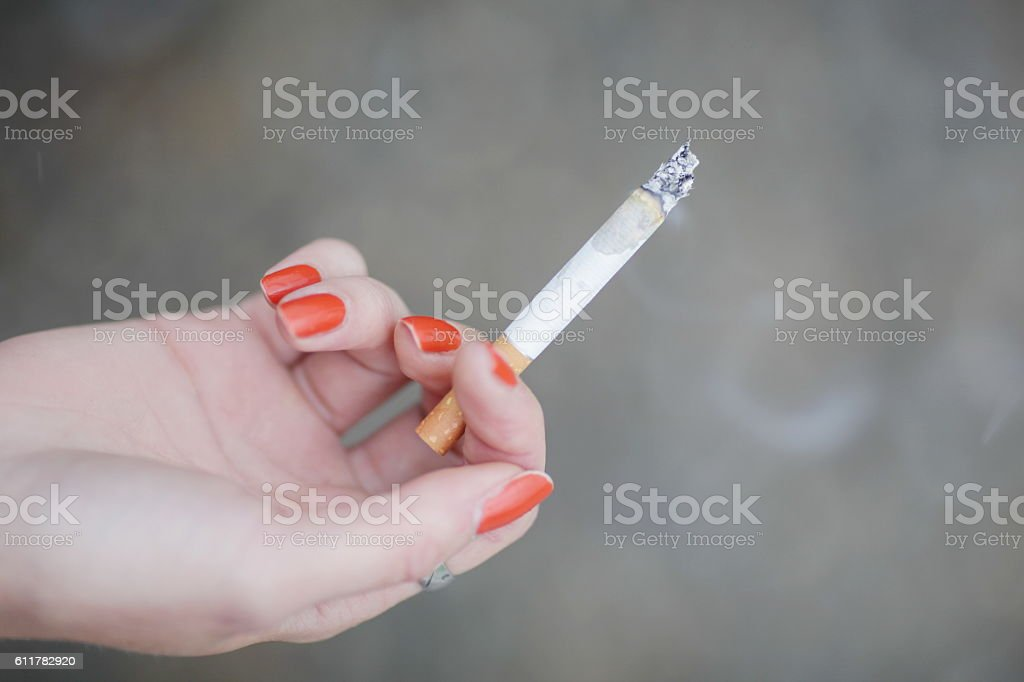 Female hand with cigarette stock photo
