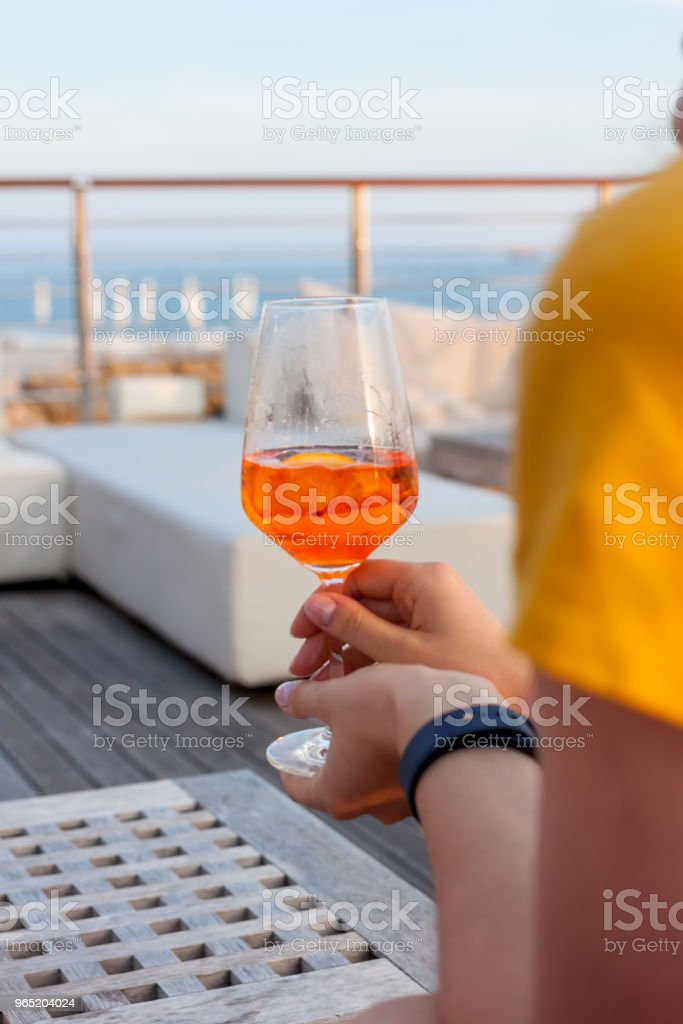 female hand with glass of aperol spritz royalty-free stock photo