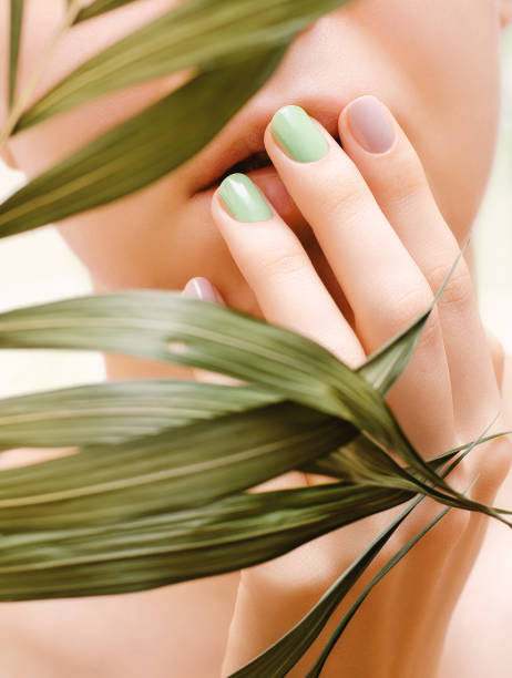 Female hand with light green nail design stock photo