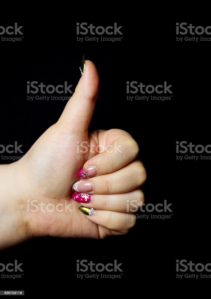Female hand with nail polish on a black background royalty-free stock photo