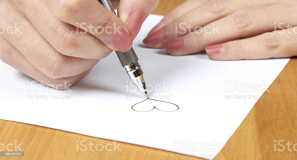 Female hand with pen on white (paper) royalty-free stock photo