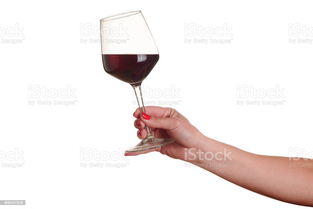 female hand with red wine glass stock photo