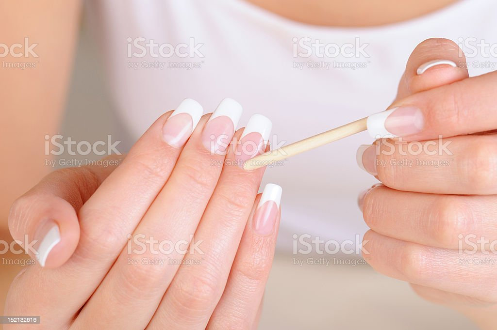 Female hand  with  stick for  cleaning cuticle stock photo
