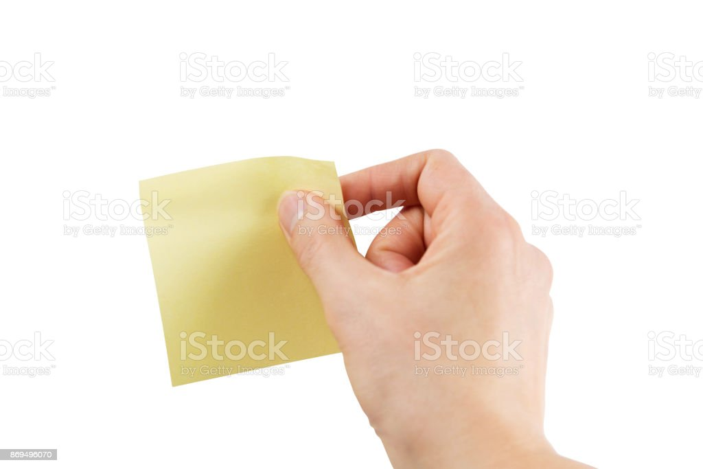 Female hand with yellow sticky note – Isolated with clipping path