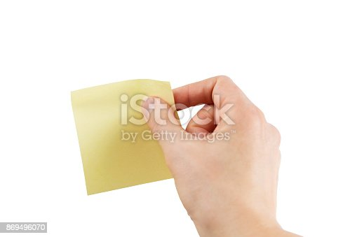 istock Female hand with yellow sticky note – Isolated with clipping path 869496070