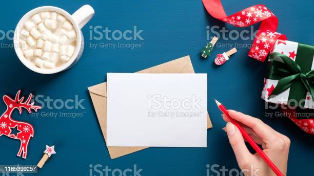 Female hand writing letter to santa claus over dark blue background picture id1185399257?b=1&k=6&m=1185399257&s=612x612&h=2ifqr0qh46f5txjndrqeafes8uyeppn8rajkpht pwi=