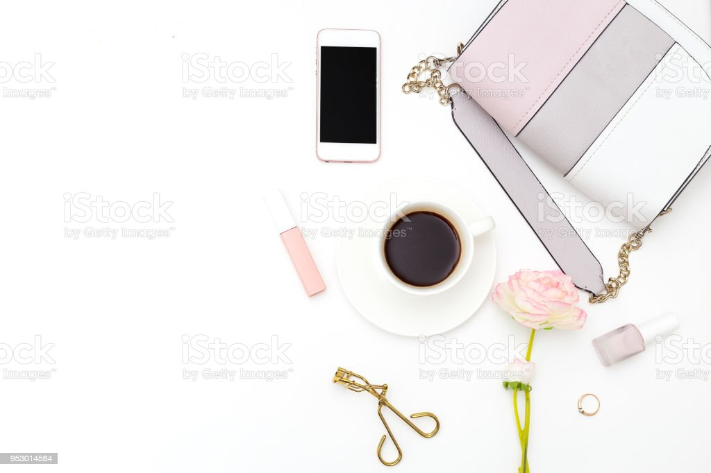 Female handbag and phone on white background. Copy space stock photo