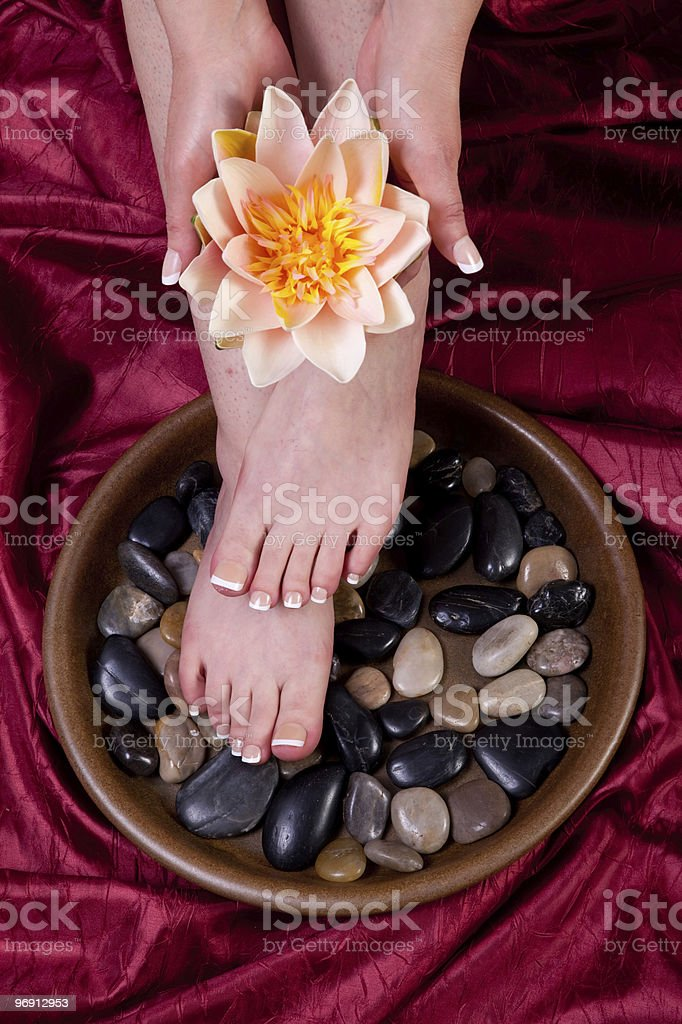 Female hands and feet royalty-free stock photo