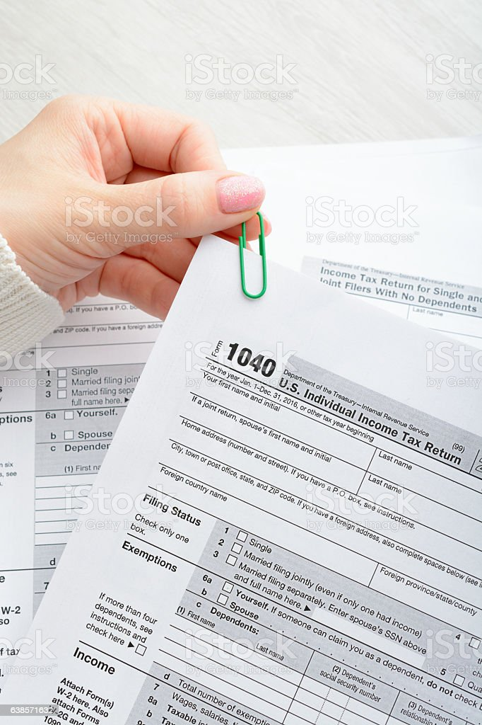 Female hands and tax form stock photo