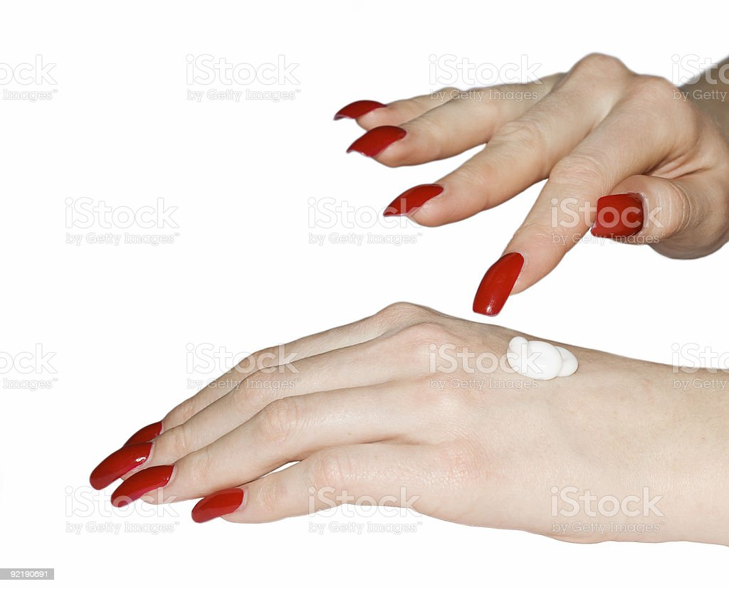 Female Hands Applying Cream royalty-free stock photo