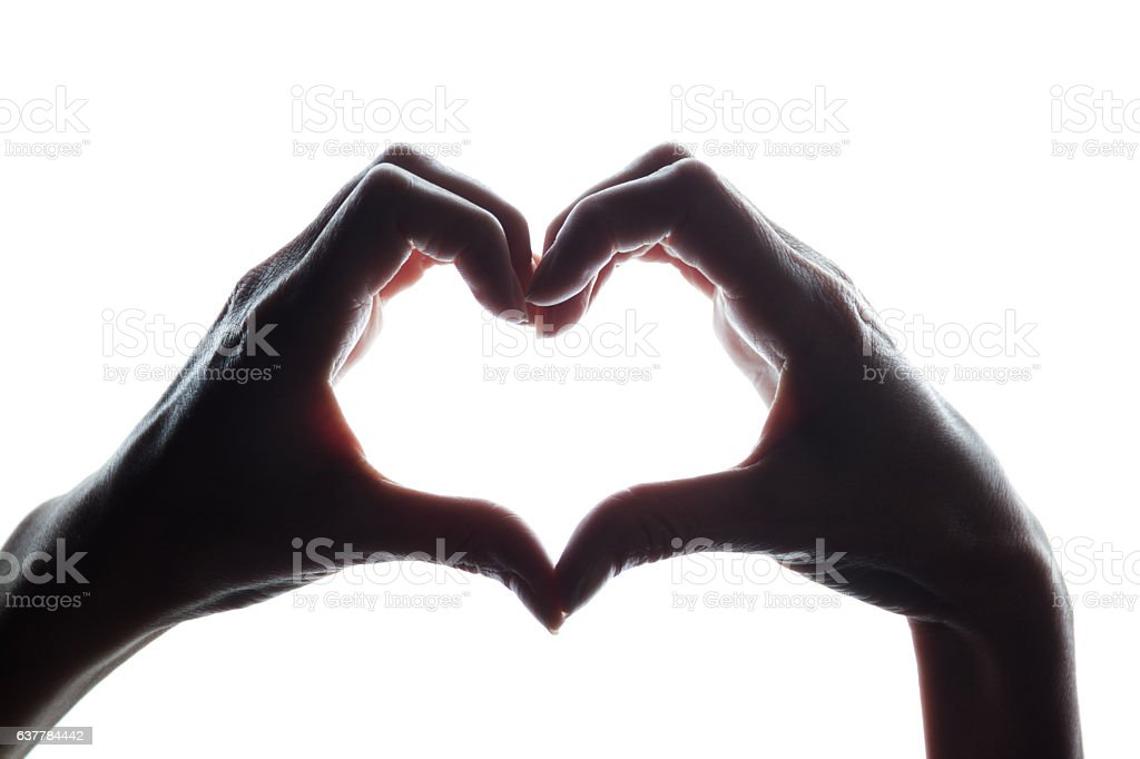 Female hands as a symbol of the heart stock photo