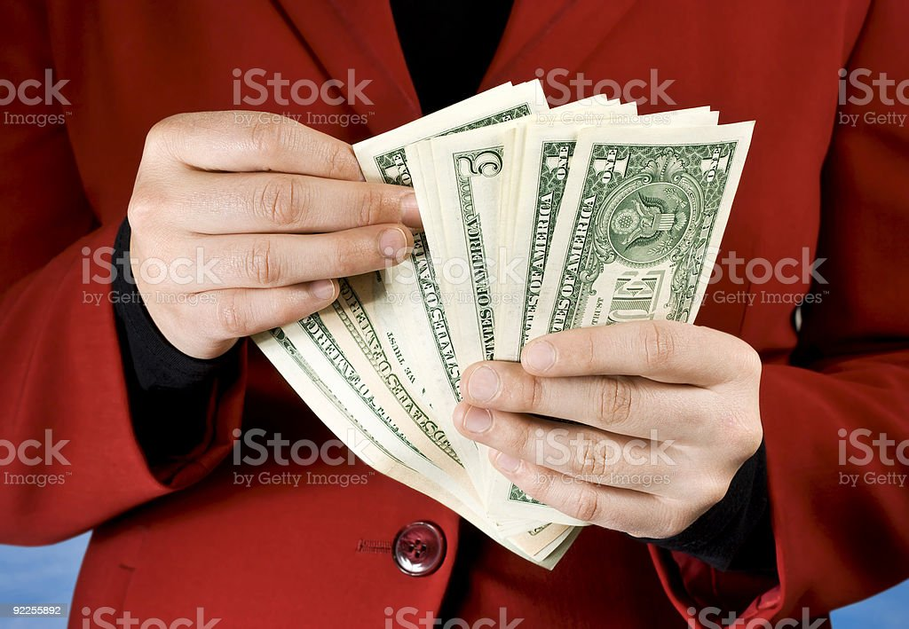 Female hands counting dollar banknotes royalty-free stock photo