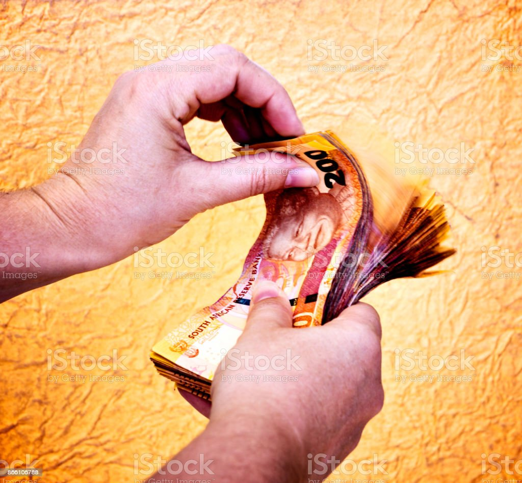 Female hands counting thick sheaf of South African banknotes stock photo