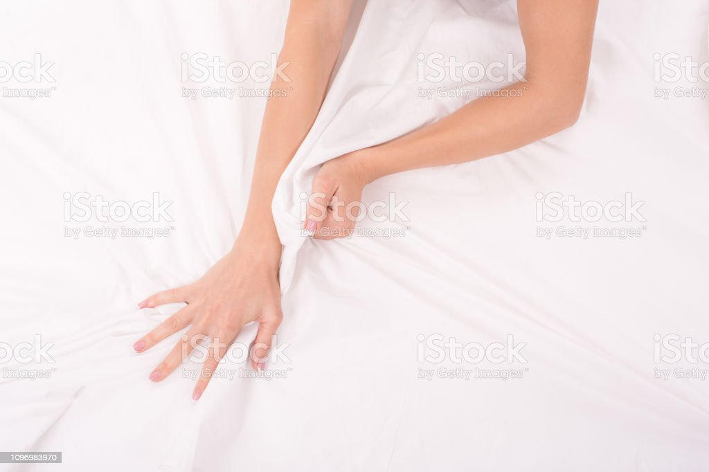 Female hands crumple white sheet, woman making sex, focus on hands - Royalty-free Abstract Stock Photo