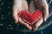 istock Female hands giving red heart. Close up. 1085215586