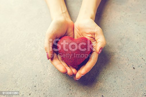 istock Female hands giving red heart 910061080
