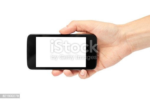 istock Female hands hold a cell phone, mockup template. Isolated on white background 821900278