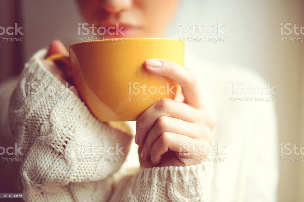 Female hands hold a coffee cup closeup stock photo