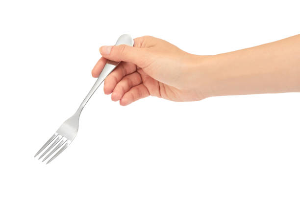 Female hands hold a fork. Isolated on white background stock photo